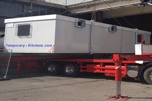 temporary kitchen being delivered on a trailer